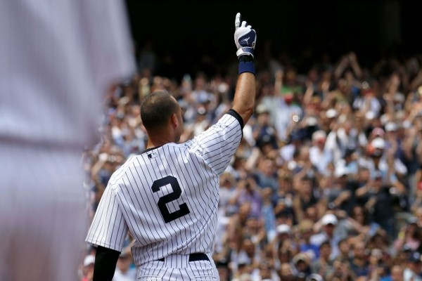 NEW YORK, NY - JULY 09: Derek Jeter #2 of the New York Yankees waves to the fans after hitting a solo home run in the third inning for career hit 3000 while playing against the Tampa Bay Rays at Yankee Stadium on July 9, 2011 in the Bronx borough of New York City. (Photo by Nick Laham/Getty Images)